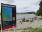 One of two signs erected at the lake edge on Thursday